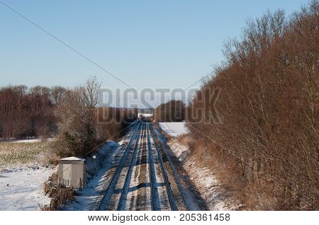 Railway tracks in the Danish winter landscape