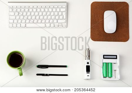 E-cig, Keyboard, Computer Mouse, Battery And Coffe