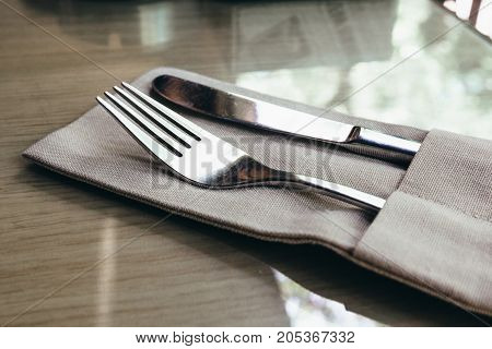 Fork and knife on the table in a restaurant