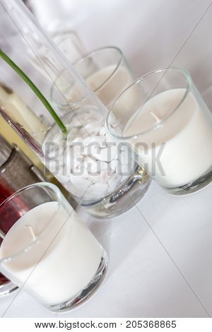 Wedding decoration. White candles on the table