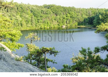 Steep granite hillside dropping to Long Pond in Hopkinton Rhode Island