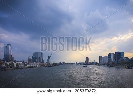 Rotterdam Netherlands -May 11 2017: Rotterdam Skyline with Erasmus Bridge In The Background As Seen From The Old Transport Bridge In May 11 2017 in The Netherlands.Horizontal Image