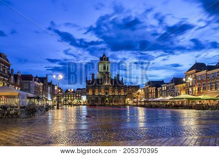 Travel Concepts and Ideas. Unique Stadhuis (Known as City Hall) at Local Markt Square (Market Place) in Dutch Old City Delft during Blue Hour in Holland the Netherlands. Horizontal Shot