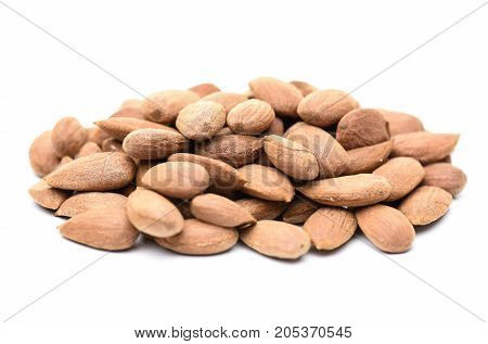 a lot of almonds and white background