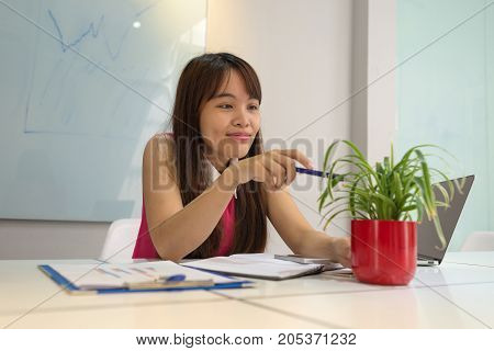 Young office girl enjoy her break time with green tree