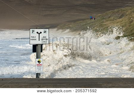Large winter storm sends huge waves covering the beach and boat ramp in Pacific City, Oregon.