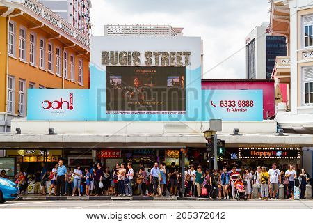 SINGAPORE - SEPTEMBER 7 2017: Shoppers waiting outside Bugis Street Market a bargain place renowned for cheap food; clothing souvenirs electronics houseware and cosmetics.