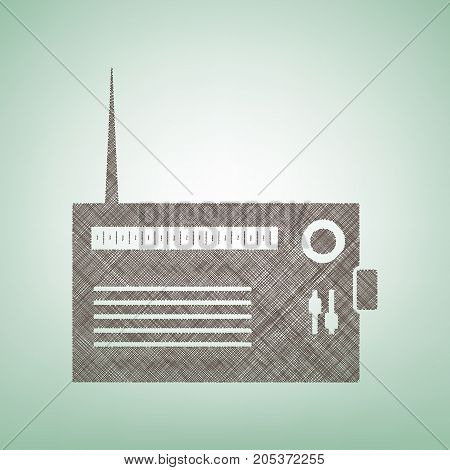 Radio sign illustration. Vector. Brown flax icon on green background with light spot at the center.
