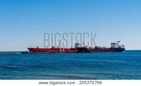 MISSISSAUGA, CANADA - OCTOBER 10 2016: Two tanker ships are docked at the Suncor Energy lubricants plant on the northern shore of Lake Ontario.