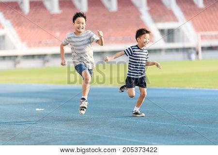Boy Running On The Blue Track