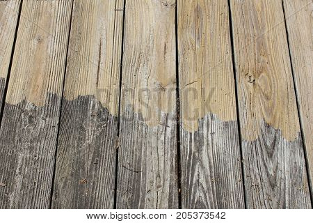 Pressure washed wood with uneven border, horizontal aspect