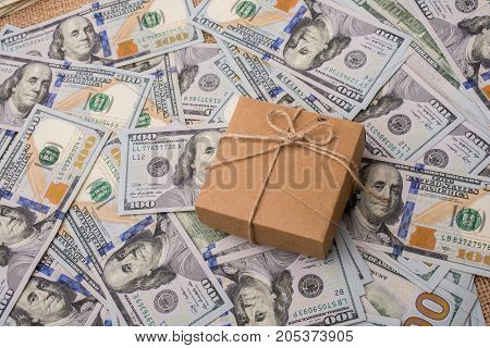 Gift Box Placed On Spread Us Dollar Banknotes