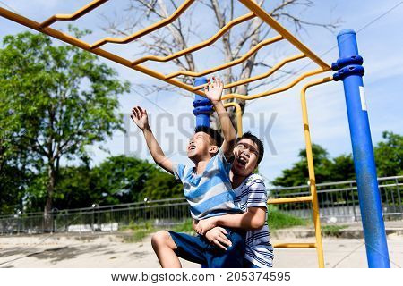 Young Asian Boy Hang  Out Door Playground