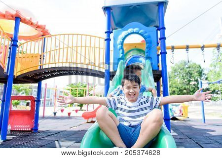 Young Asian Boy At Out Door Playground