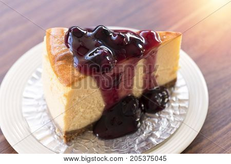 Homemade Blueberry New York Cheesecake On White Plate