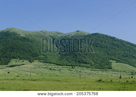 Green mountains of Armenia. horizontal shot in the afternoon