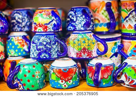 Colorful traditional mexican ceramics dishes on the street market