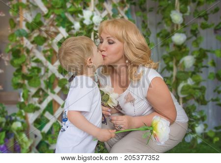 Granny grandson, both blonde kisses, cuddling and kissing. indoors