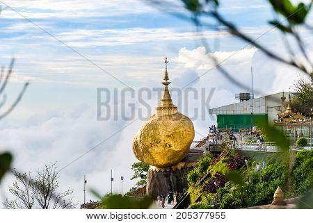 Kyaikto, Mon state, Myanmar - September 8 2017: Burmese people pray and worship by sticking the gold leaf to the Lord Buddha relics in Kyaiktiyo pagoda or Golden rock pagoda Myanmar.