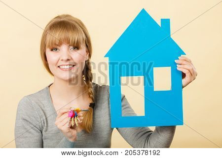 Young Blonde Lady With Bunch Of Keys.