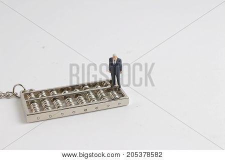 Business Man And The Abacus At White Board