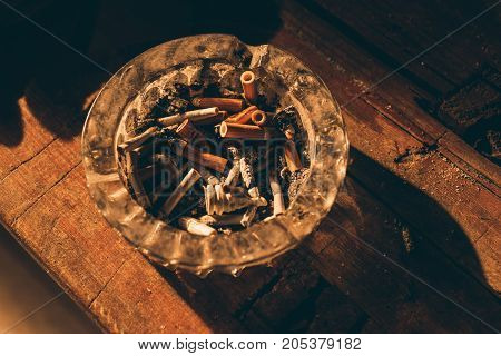 Ashtray with cigarette butts. Object photo. horizontal shot