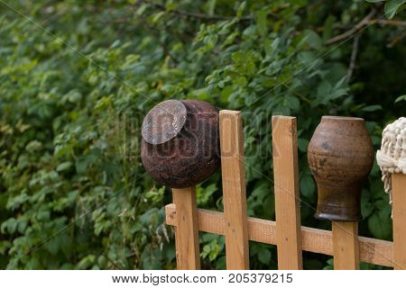 cast-iron bowler on a wooden fence. horizontal day shot close-up