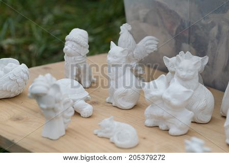plaster figurines of animals. horizontal day shot close-up