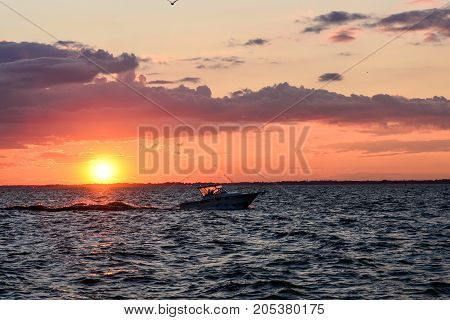 a boat crossing the sunset in Sandusky bay On Lake Erie