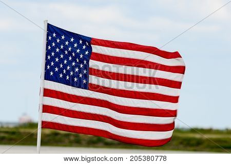 American Flag flying high on a the windy day