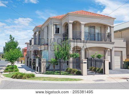 typical facade of a modern suburban house at noon