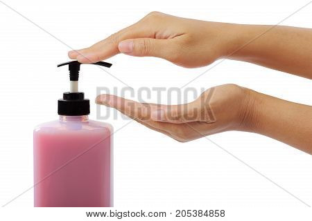 Woman hands pushing pump plastic bottle isolated on white background, clipping path.