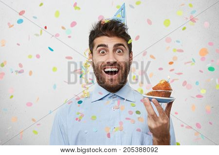 Headshot Of Excited Young Man Celebrating His Anniversary, Having Euphoric Ecstatic Look, Wearing Ho