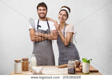 Delightful Family Couple Cook Together At Kitchen, Prepare Delicious Supper For Children, Use Variou