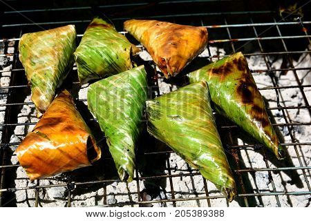 Black Sticky Rice with Coconut Milk and Taro khao-nieo-ping Grilled stuffed Glutinous rice wrapped in banana leaves