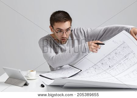 Isolated Picture Of Shocked Terrified Young Student Engineer Wearing Round Eyeglasses Feeling Panic