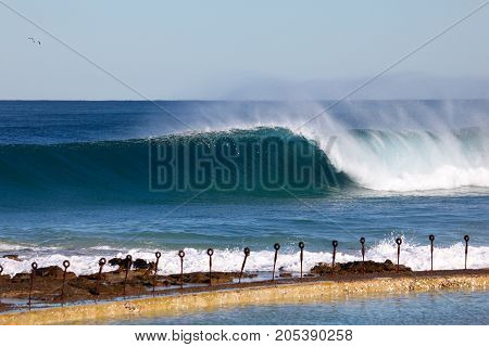 A powerful wave breaks towards newcastle ocean baths. Newcastle is Australia's second oldest city with surf beaches wlking distance from the CBD area.