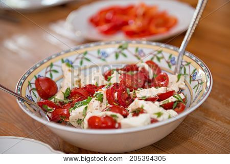 tomato and Mozarella- salad on wooden table