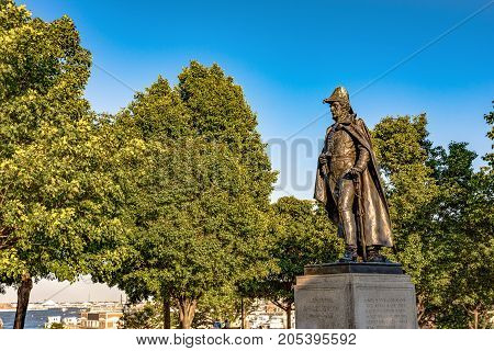 Baltimore Maryland USA - July 9 2017: Statue of General Samuel Smith on top of Federal Hill with the Inner Harbor in the background. Smith was an officer in the Continental Army Congressman Senator and mayor of Baltimore.