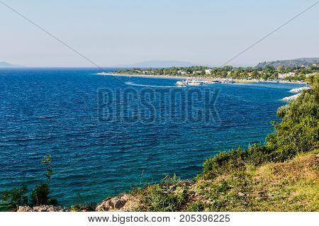 Landscape of beautiful settlement in calm bay coast.