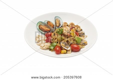 Seafood pasta Spaghetti with Clams Prawns Seafood Cocktail isolated on white background clipping path.