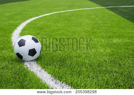 Soccer Ball On Artificial Bright And Dark Green Grass At Public Outdoor Football Or Futsal Stadium