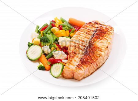 Plate Of Grilled Salmon Steak Isolated On White Background