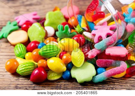 Various Colorful Candies, Jellies And Marmalade In Glass Jar