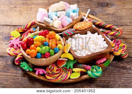 Various Colorful Candies, Jellies, Lollipops, Marshmallows And Marmalade