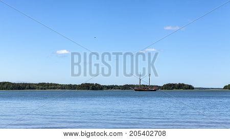 BALTIC SEA, ALAND ON JULY 01. View of a sailboat, the Baltic Sea and the archipelago on July 01, 2017 in Baltic Sea, Finland. Sunny day at sea. Unidentified boat. Editorial use.