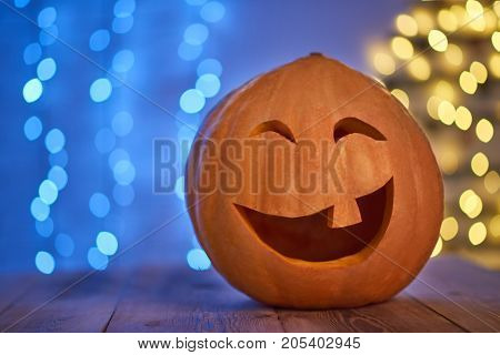 Shot of a Halloween pumping with a laughing face placed on the table copyspace celebrating autumn vegetable traditional tradition.
