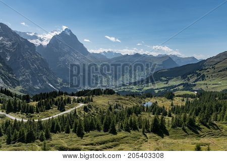 View From Grosse Scheidegg To The Grindelwald Valley, Swiss Alps, With Eiger Peak Visible In Clouds,