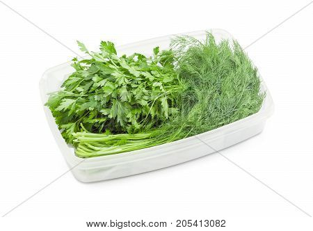 Bundles of the freshly harvested dill and parsley in white plastic container on a white background