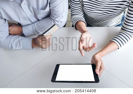 Two people using tablet and credit/debit card register payments online shopping and customer service network connection market using technology on global Internet Online shopping or banking concept.